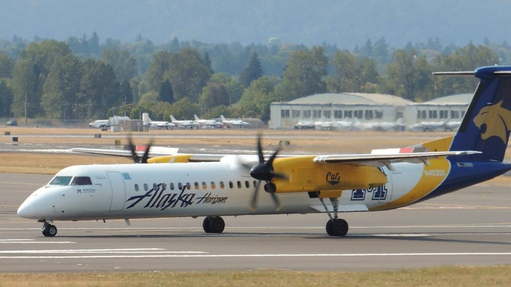 Alaska Airlines (Horizon) Bombardier DHC 8 Q400 Montana State University Bobcats [N403QX] takeoff from PDX