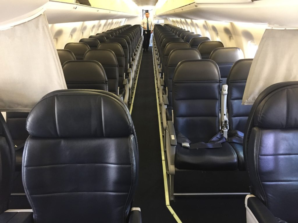 Alaska Airlines (Skywest) Embraer 175 seated in a 1-2 configuration in first class and a 2-2 configuration in economy