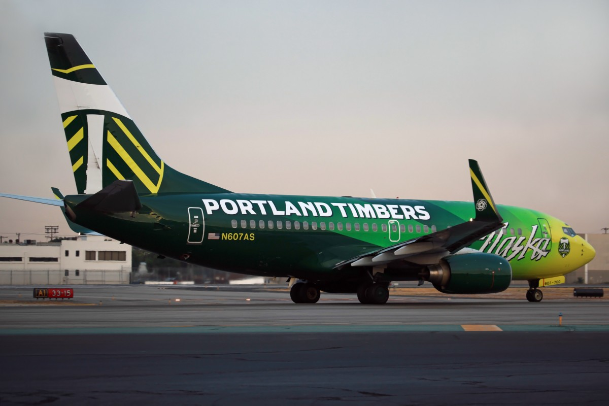 Alaska Airlines, the green 'Portland Timbers' logojet livery