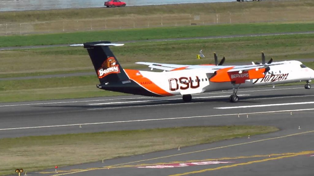Alaska Horizon Air Bombardier Q400 With The OSU Beavers Paint Job Takes Off From KPDX On Runway 10L