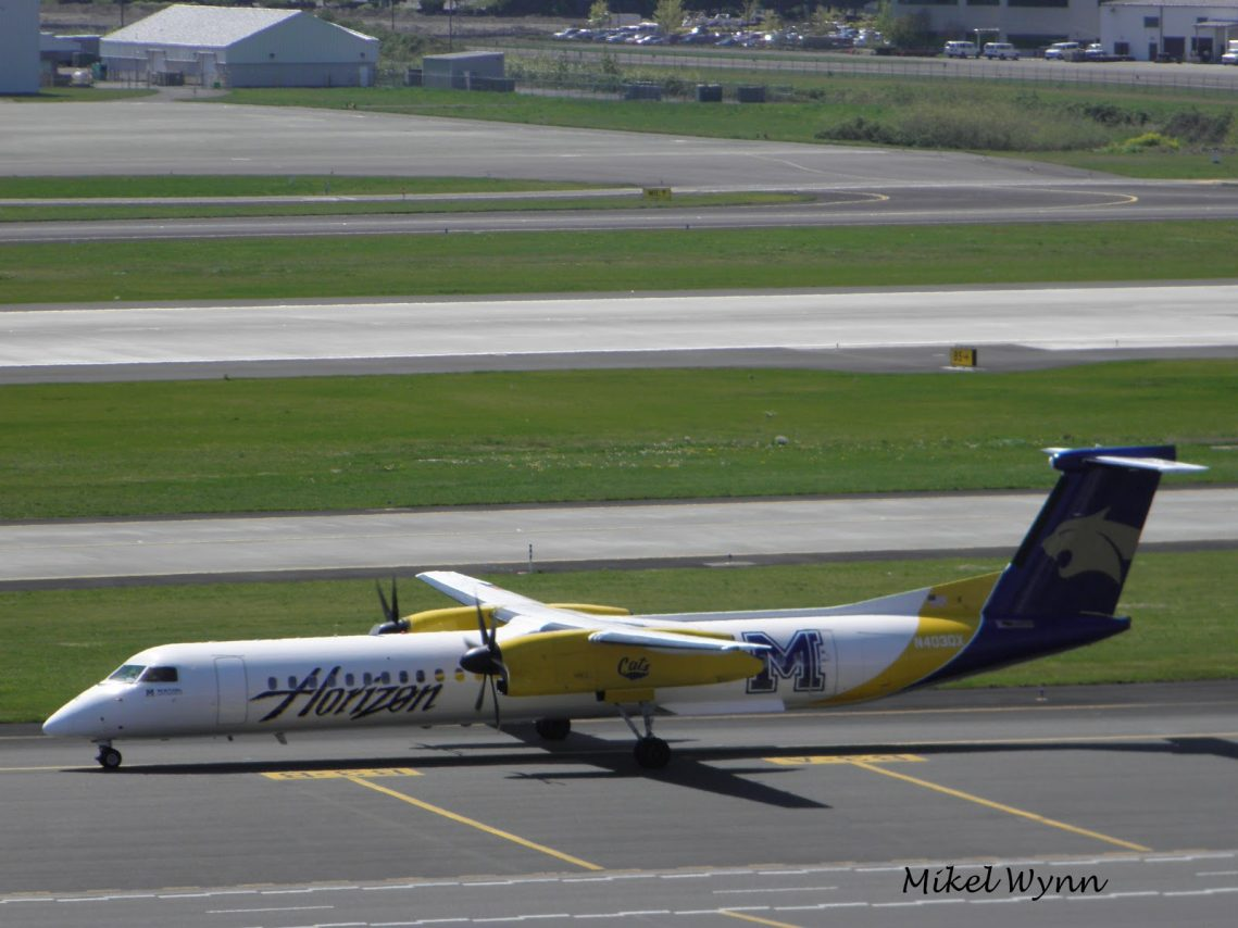 Alaska Horizon Air with Montana State University Bobcats special livery De Havilland Dash 8 DHC-8 Q401 (N403QX) taxiing to gate at PDX. Portland, Oregon @Mikel Wynn