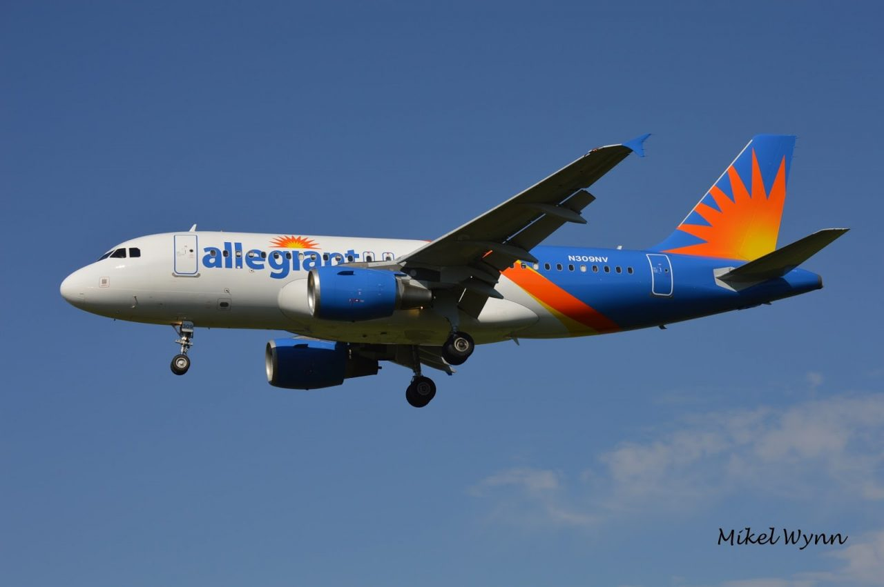 Allegiant Air Airbus A319-111 (N309NV) sporting the airline's new livery on short final for 13 arriving from Oakland as AAY1004 @Mikel Wynn