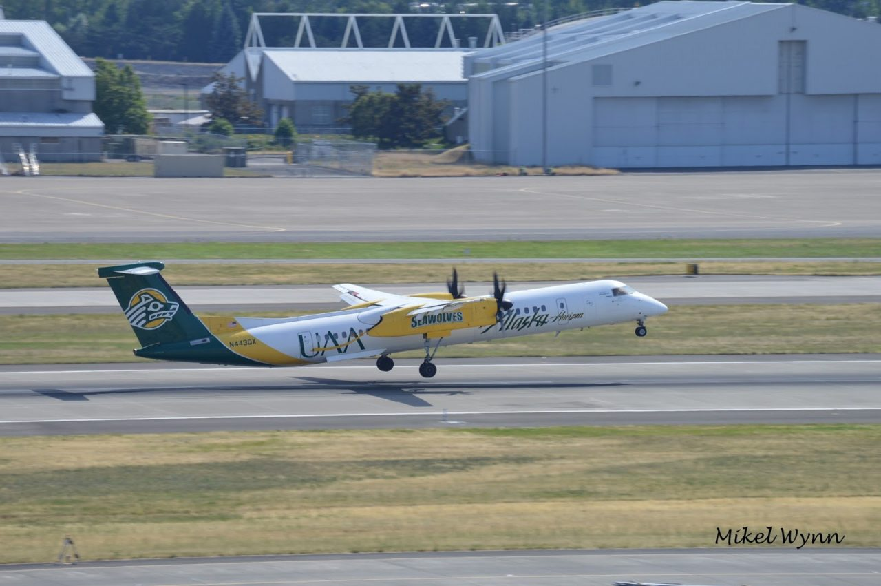 Horizon Air (d:b:a Alaska Airlines) Bombardier DHC-8-402 Dash 8 Q400 (N443QX) in the University of Alaska at Anchorage Seawolves livery departing via 28L as QXE2253 for Reno:Tahoe @Mikel Wynn