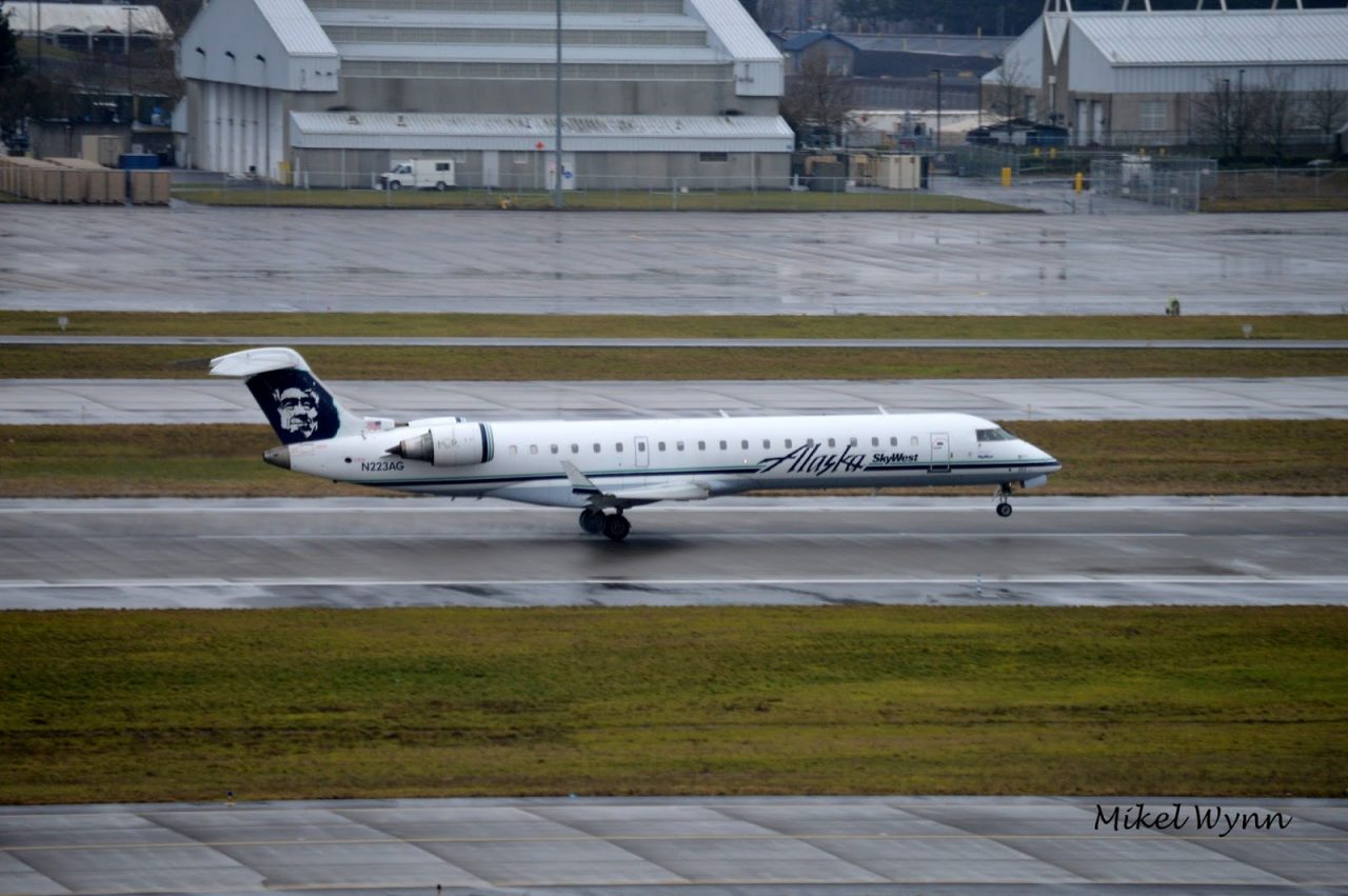 SkyWest Airlines (d:b:a Alaska Airlines) Bombardier CL-600-2C10 CRJ-700 (N223AG) rotating on 28L for departure as SKW3342 to Seattle:Tacoma credit - Mikel Wynn