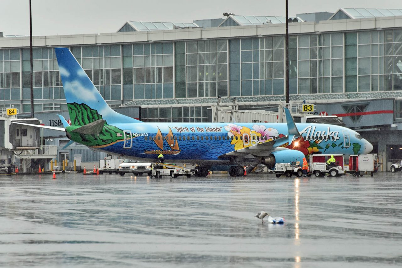 passenger boarding process on Alaska Airlines Boeing 737-800 Spirit of The Islands Aircraft