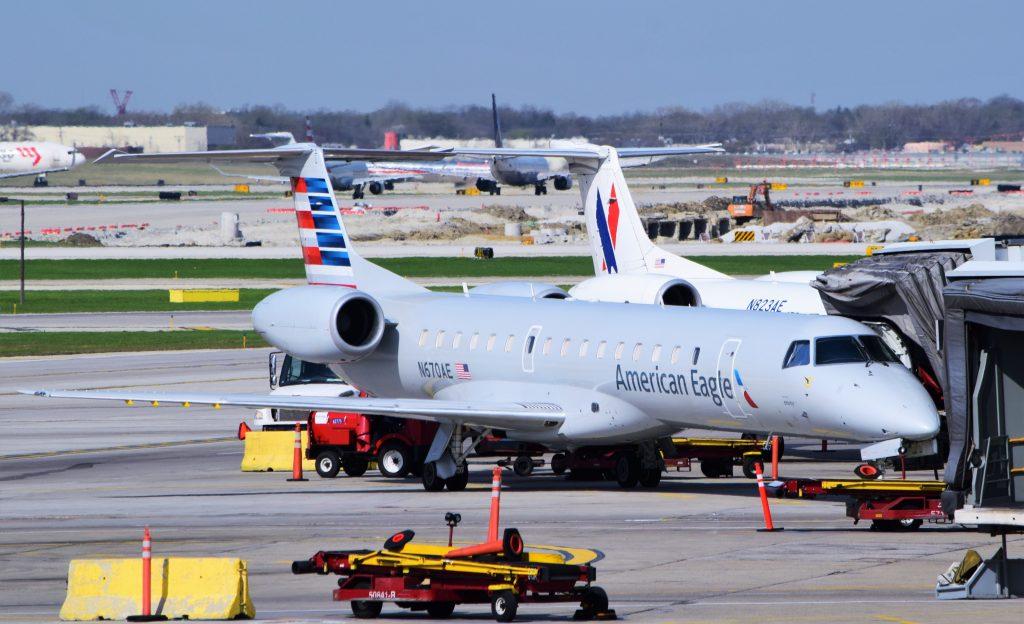 A pair of American Eagle (Envoy Air) ERJ-145s (N670AE, N823AE) parked at Chicago-O'Hare