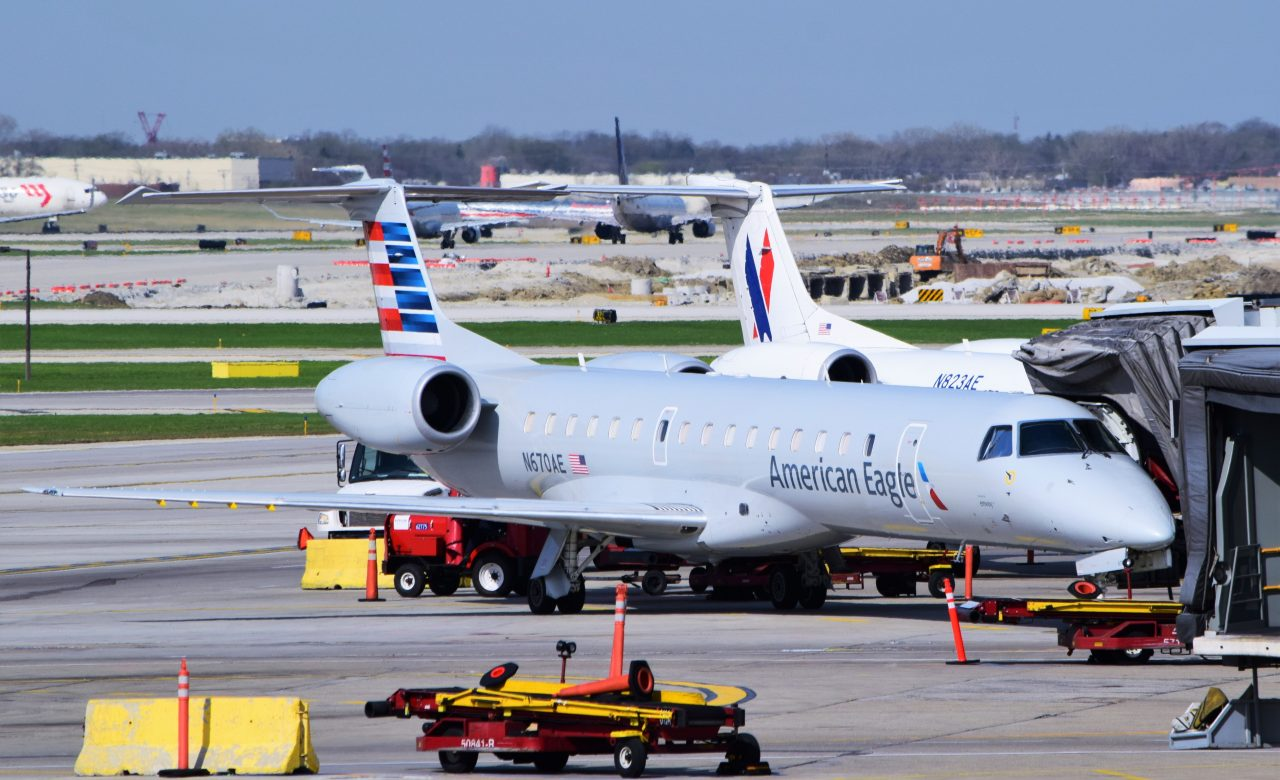 A pair of American Eagle (Envoy Air) ERJ-145s (N670AE, N823AE) parked at Chicago-O'Hare