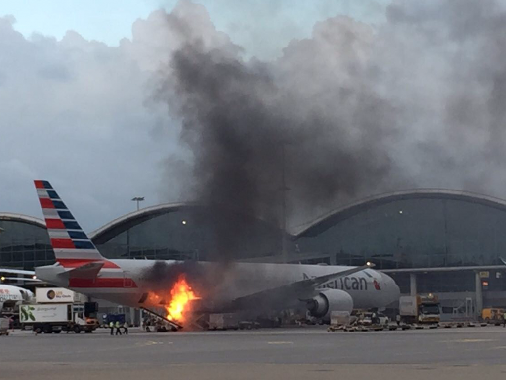 American Airlines Flight 192 Boeing 777-300ER On Fire at Hong Kong International Airport
