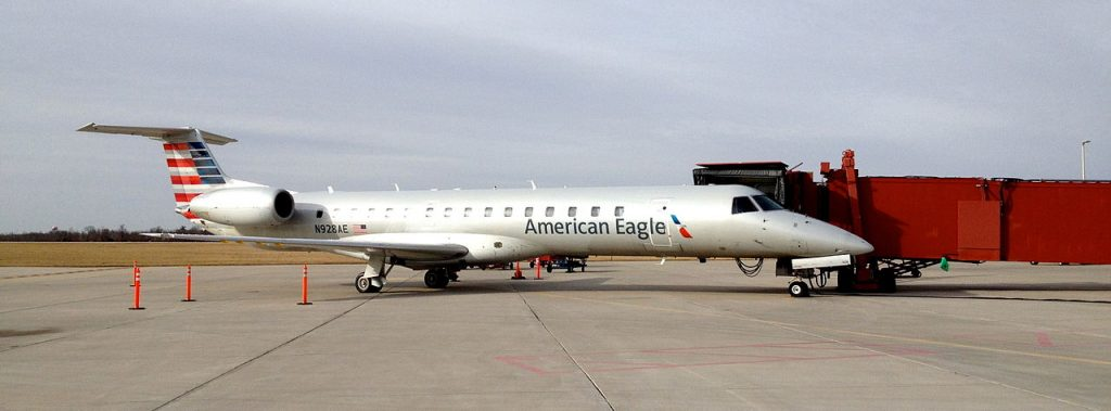 American Eagle Airlines Embraer ERJ-145 N928AE parked at gate 1