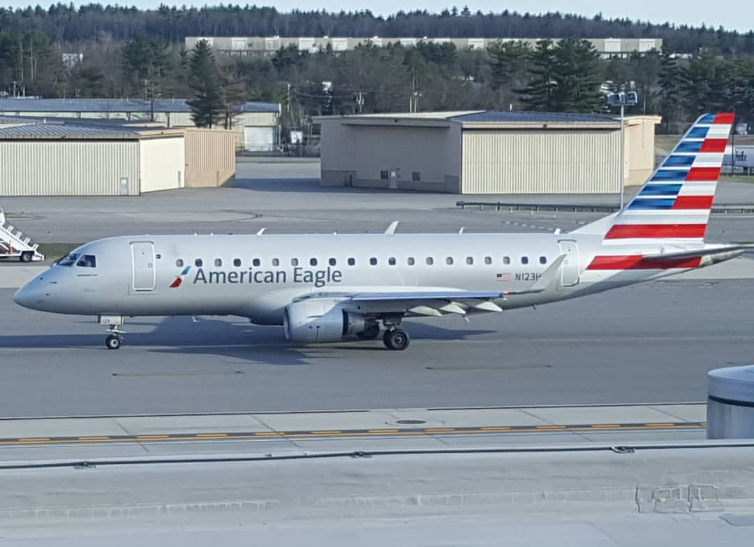 American Eagle Airlines Embraer erj-175 taxiing to runway 35 at KMHT