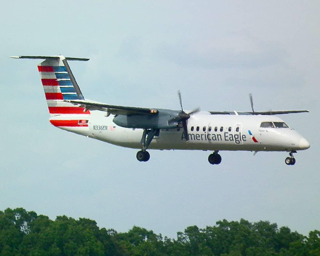 American Eagle Piedmont Airlines Bombardier Dash 8-300 N336EN landing on 18L