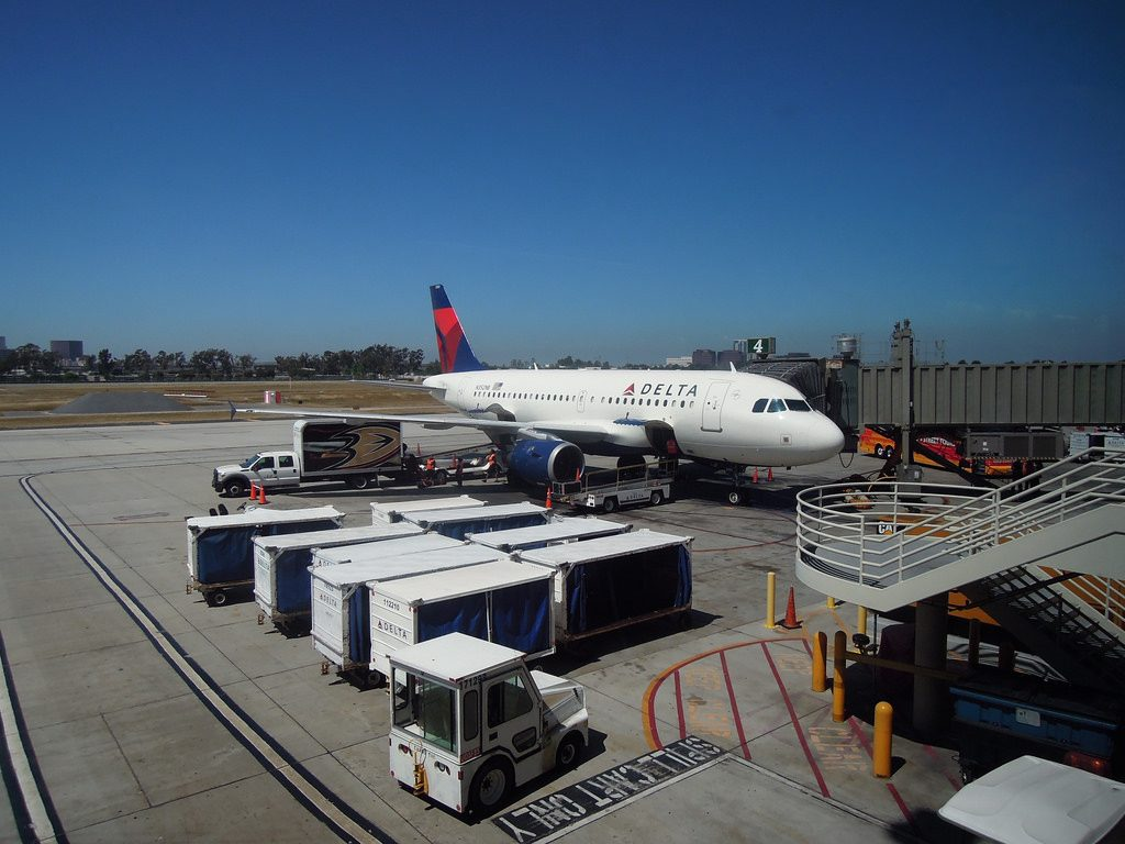 Delta Air Lines Airbus A319-100 N352NB Unloading Anaheim Ducks' gear from Newark at John Wayne Airport