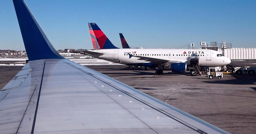 Delta Air Lines Airbus A319-100 N371NB jet sits on the tarmac at LaGuardia Airport