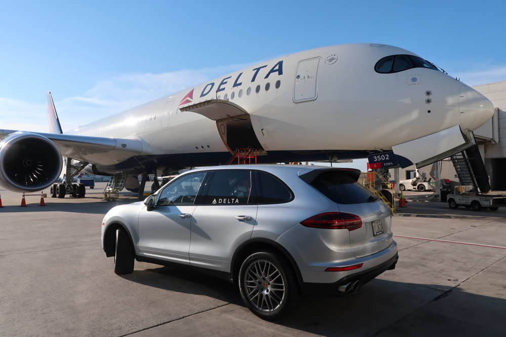 Delta Air Lines Airbus A350-900 Business Class (Delta One) service agent Porsche Cayenne and drove across the ramp to next flight