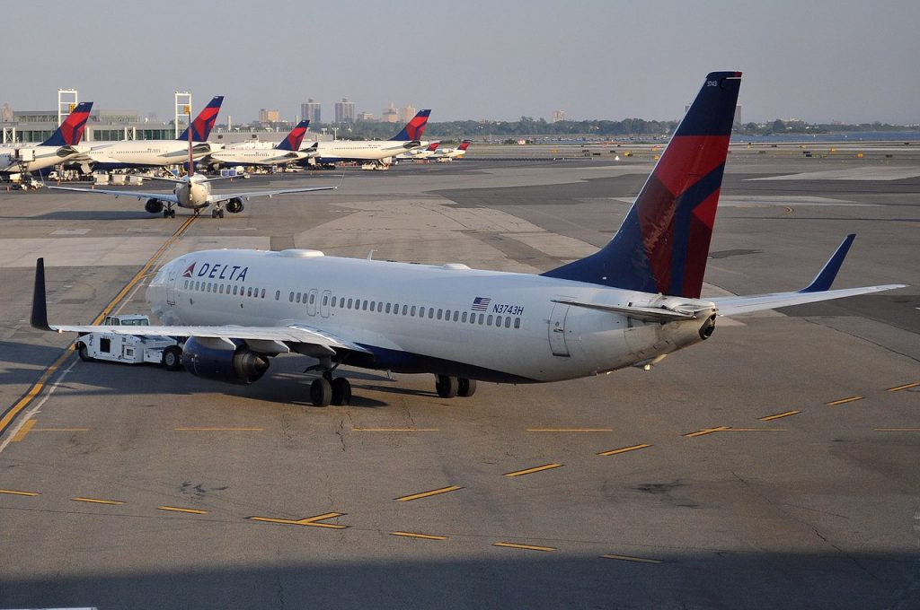 Delta Air Lines Boeing 737-832 N3743H pushback by tug at John F. Kennedy International Airport