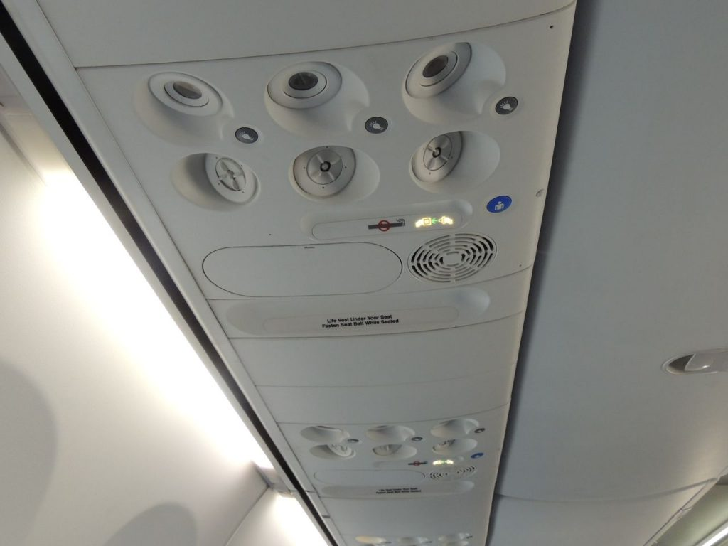 Delta Air Lines Boeing 737-900ER Main Cabin Economy Class BSI overhead console Photos