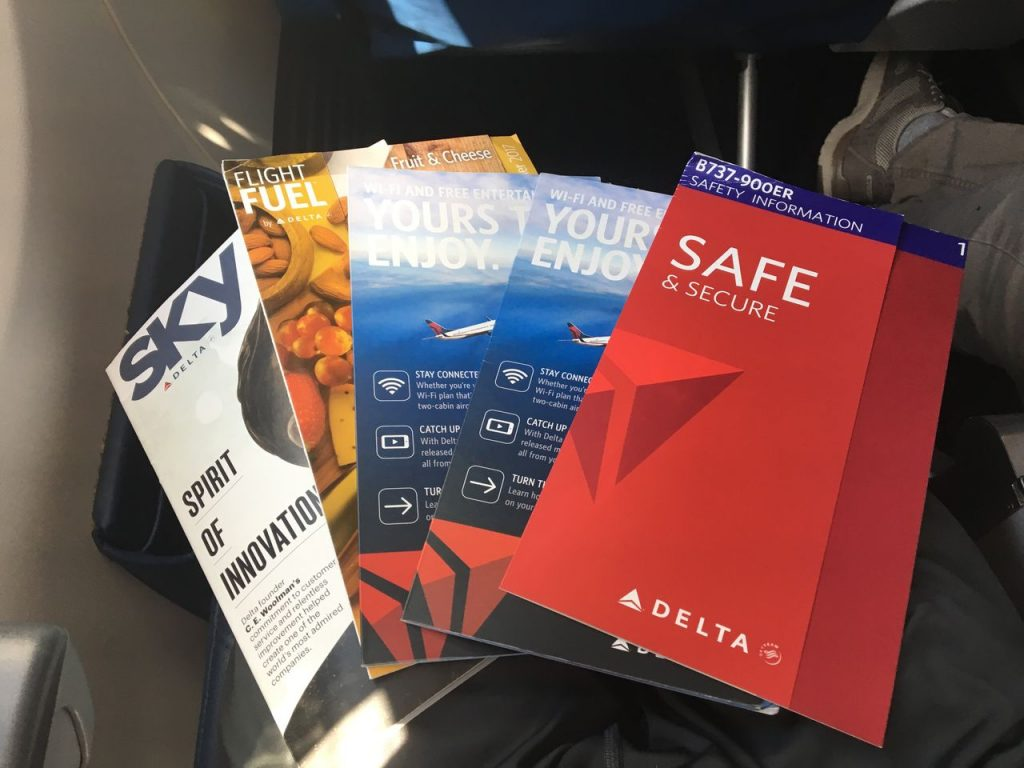 Delta Air Lines Boeing 737-900ER Premium Economy (Comfort+) Class Seatpocket literature- In-flight magazine, buy-on-board menu, safety card, and two wifi:entertainment guides Photos