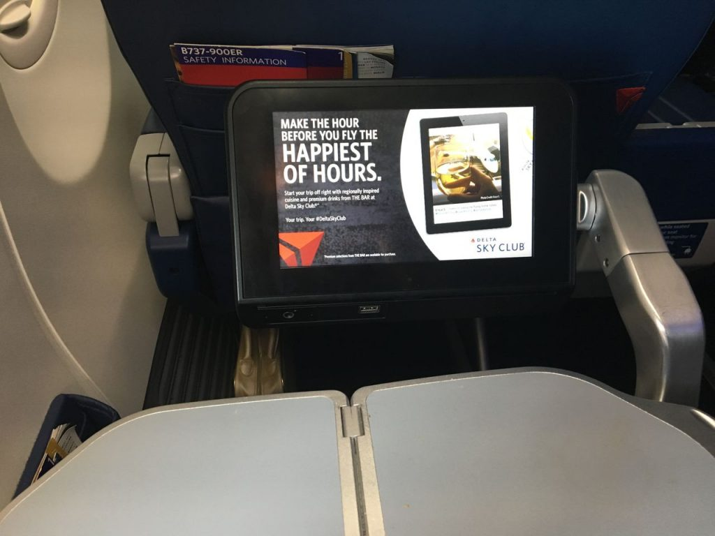 Delta Air Lines Boeing 737-900ER Premium Economy (Comfort+) Class entertainment system and the fold-out tray table Photos