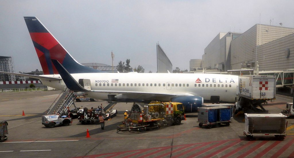 Delta Air Lines Fleet Boeing 737-732 N307DQ cn:serial number- 29679:2767 passenger and cargo boarding at Mexico City International Airport