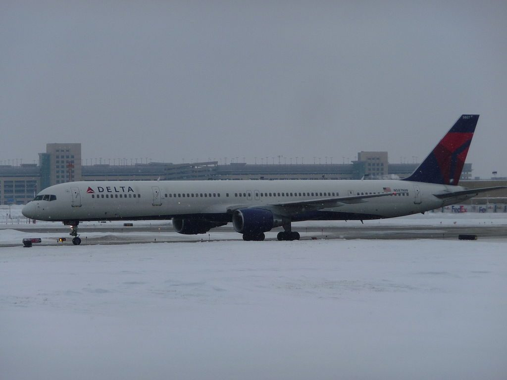 Delta Air Lines Aircraft Fleet N587NW, Boeing 757-300 with the Pratt & Whitney PW2043 engines Taxiing on snowy runway at Minneapolis–Saint Paul International Airport
