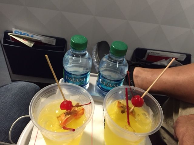 Delta Air Lines Boeing 757-300 first class cabin pre-departure drinks services photos