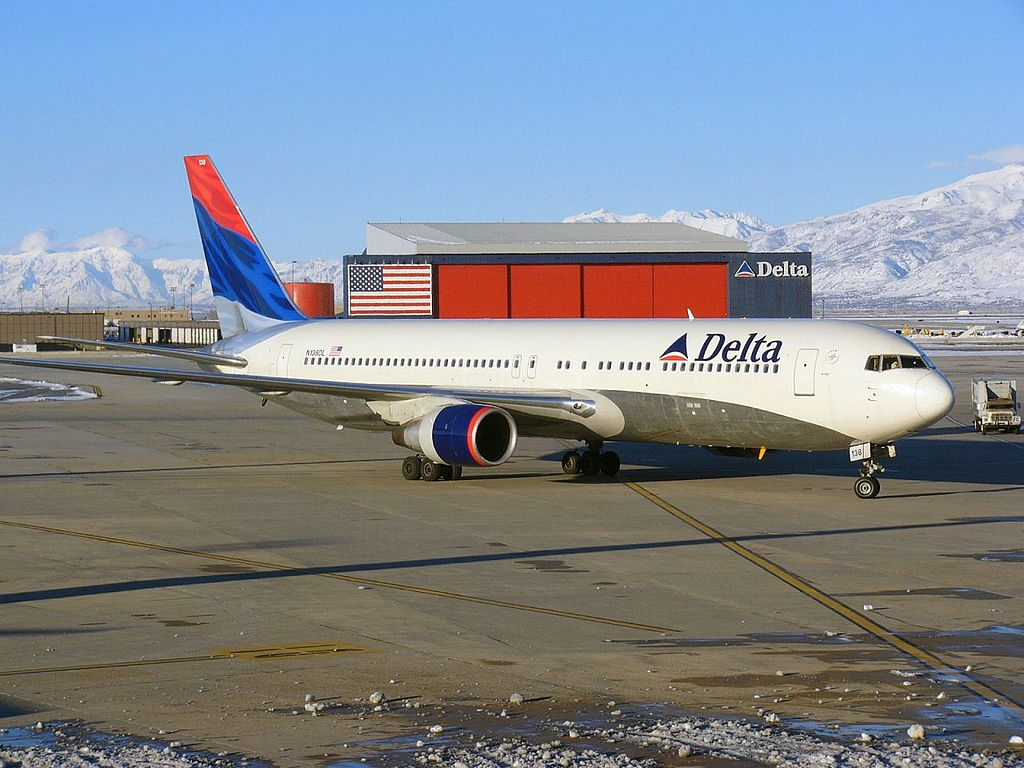 Delta Air Lines Boeing 767-300 (N138DL) at Salt Lake City Int'l Airport with Delta hangar also shown