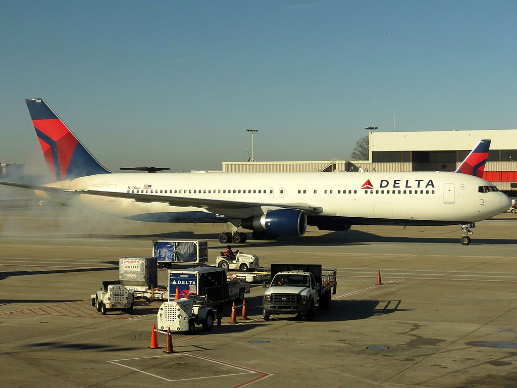 Delta Air Lines Boeing 767-300 N140LL Smoke From Landing Gears at Hartsfield-Jackson Atlanta International Airport