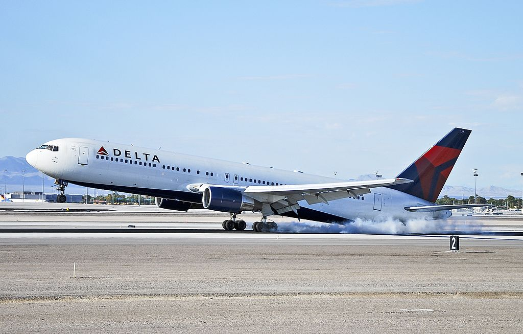 Delta Air Lines Boeing 767-332 N137DL tailstrike the runway at Las Vegas - McCarran International (LAS : KLAS) USA - Nevada, August 23, 2012