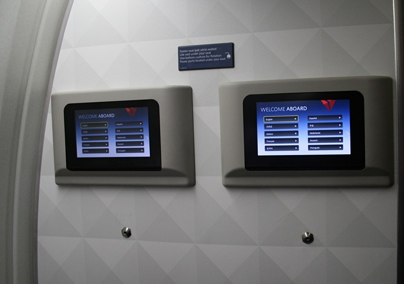 Delta Air Lines Fleet Boeing 767-300ER comfort+ (premium economy) cabin bulkhead entertainment screens photos