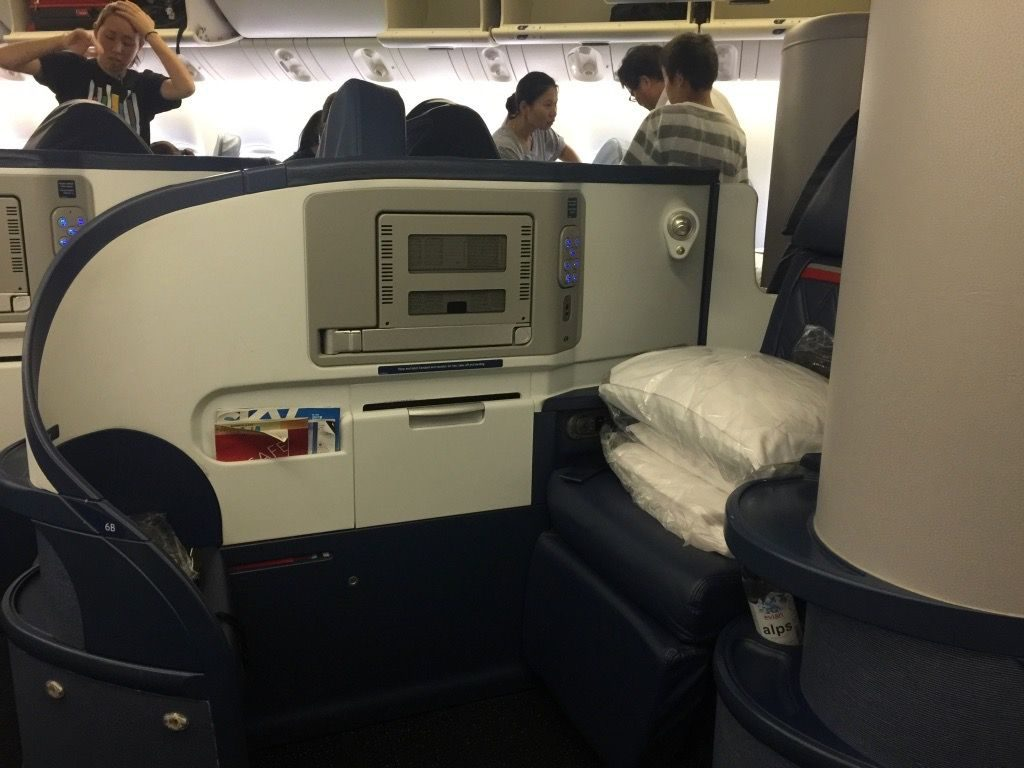 Delta Air Lines Fleet Boeing 777-200ER Business Elite Class (DELTA ONE) cabin aisle and seat row view