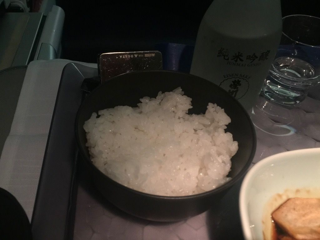 Delta Air Lines Fleet Boeing 777-200ER Business Elite Class (DELTA ONE) inflight food services main dish steamed rice