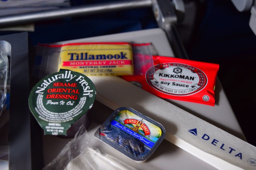 Delta Air Lines Fleet Boeing 777-200ER Premium Economy (Comfort+) inflight amenities Condiments and cheese (no crackers) service