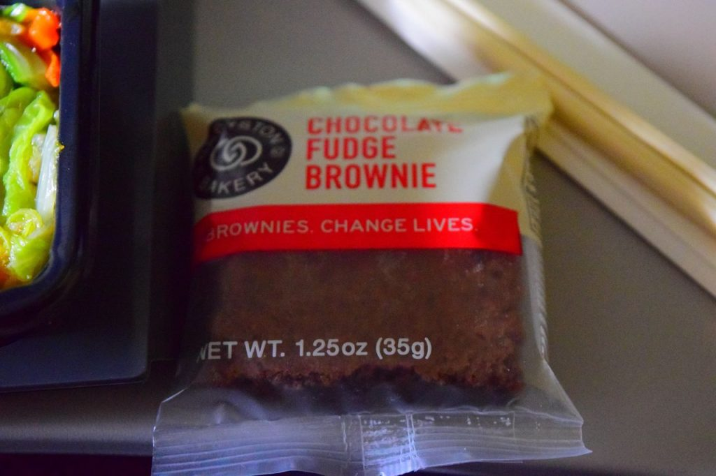Delta Air Lines Fleet Boeing 777-200ER Premium Economy (Comfort+) inflight amenities brownie for dessert service