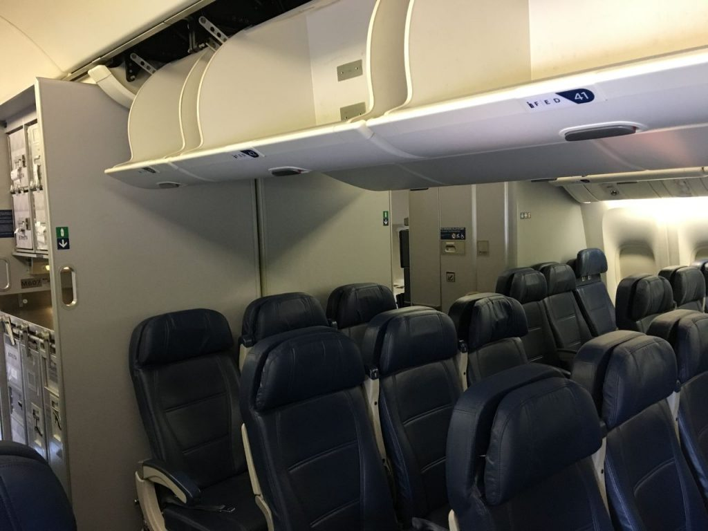 Delta Air Lines Fleet Boeing 777-200LR Main cabin economy class unique clamshell overhead bins