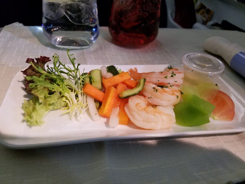 Delta Air Lines Fleet Boeing 777-200LR business elite:Delta ONE class cabin inflight meal services appetizer, salad, soup, main, cheese, and dessert photos
