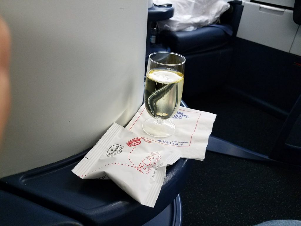 Delta Air Lines Fleet Boeing 777-200LR business elite:Delta ONE class cabin pre-departure chilled sparkling wine services