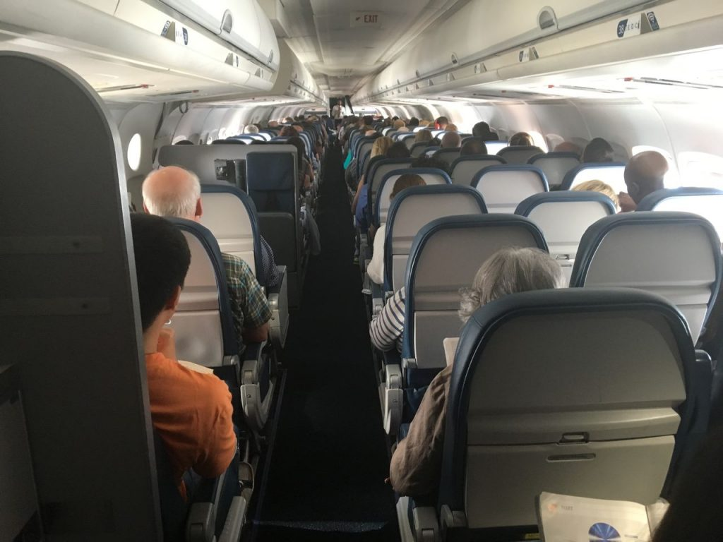 Delta Air Lines Fleet McDonnell Douglas MD-90-30 (M90) Economy Class Main Cabin from the rear
