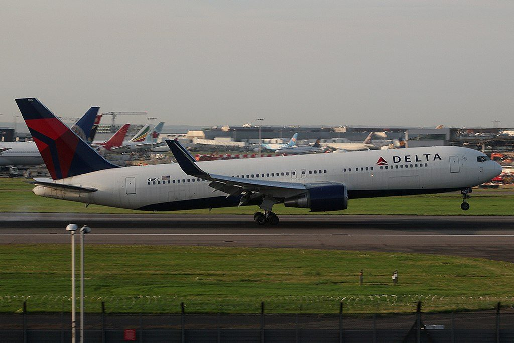 Delta Air Lines Fleet N1602 Boeing B767-332ER landing and takeoff at Heathrow Airport, UK