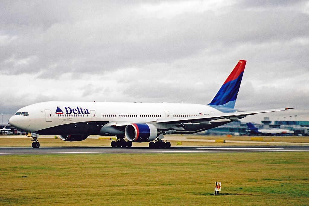 Delta Air Lines Fleet N864DA Boeing 777-232(ER) Additional 'Soaring Spirit' Winter Olympic Games, Salt Lake City, 2002 titles at Manchester Airport