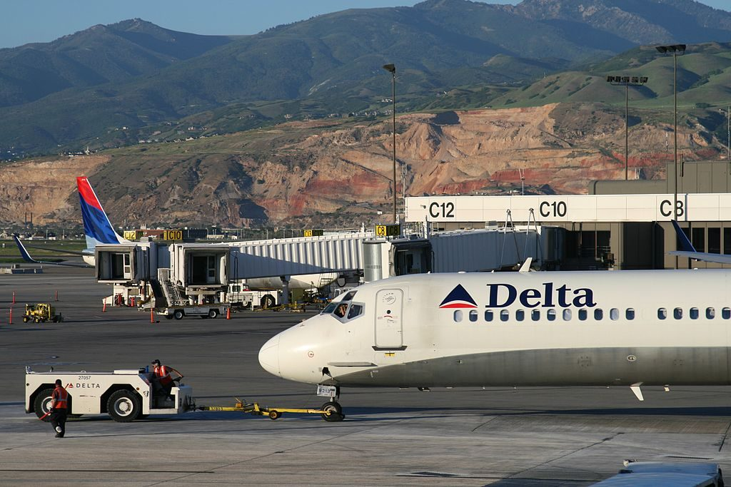 Delta Air Lines Fleet N913DN McDonnell Douglas MD-90-30 push back by tug at SLC Salt Lake City International Airport