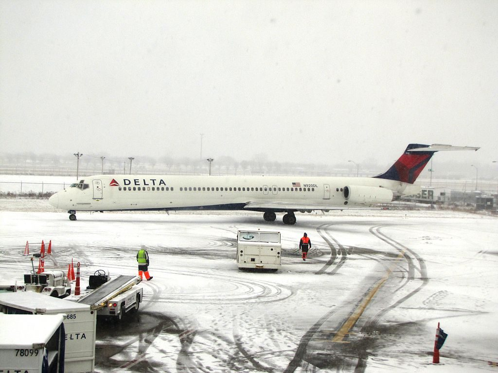 Delta Air Lines Fleet N920DL McDonnell Douglas MD-88 taxiing on snow runway at James M. Cox Dayton International Airport