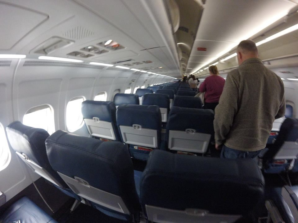 Delta Air Lines Regional Jet Fleet McDonnell Douglas MD-88 economy class cabin after landing photos