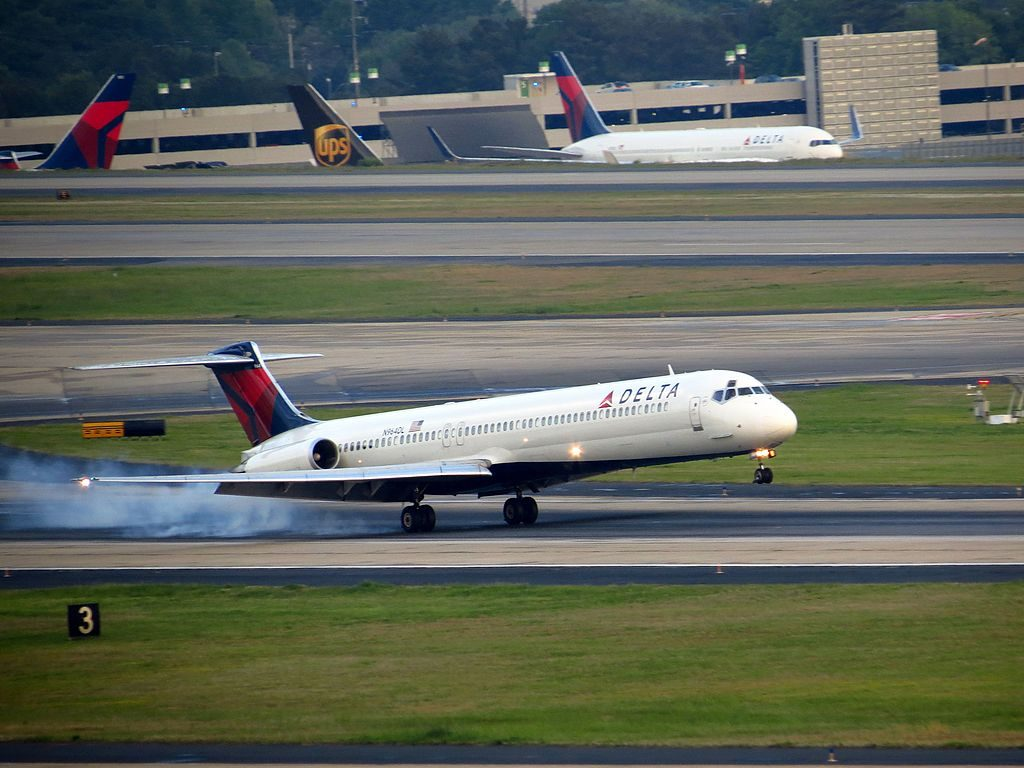 Delta Air Lines Regional Jet Fleet N964DL McDonnell Douglas MD-88 smoking landing at Hartsfield-Jackson Atlanta International Airport