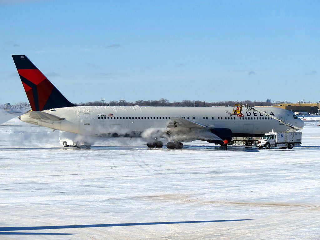 Delta Air Lines Widebody Aircraft Fleet Boeing 767-300 N129DL Snowy and Freezing Runway Minneapolis-Saint Paul International Airport