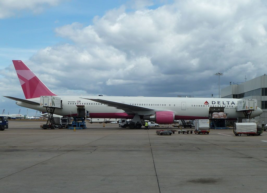 N845MH Boeing 767-400ER Delta Airlines Aircraft wearing Breast Cancer Awareness colors livery on std 407 Heathrow Airport