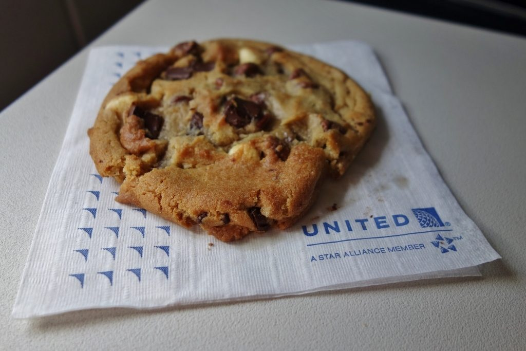 United Airlines Fleet Airbus A320-200 Business Class:Domestic First:United First pre-arrival Freshly baked Otis Spunkmeyer's chocolate chip cookies