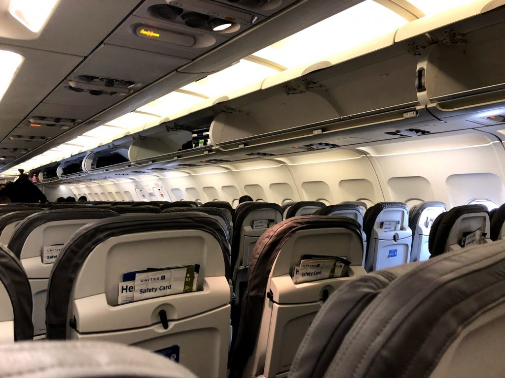 United Airlines Fleet Airbus A320-200 Main Cabin Economy Class Interior Design Seats Row and Headbins Panel Photos