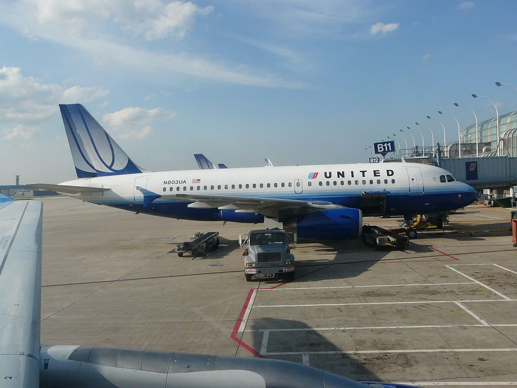 United Airlines Fleet N803UA Airbus A319-100 on boarding gate at O'Hare International Airport