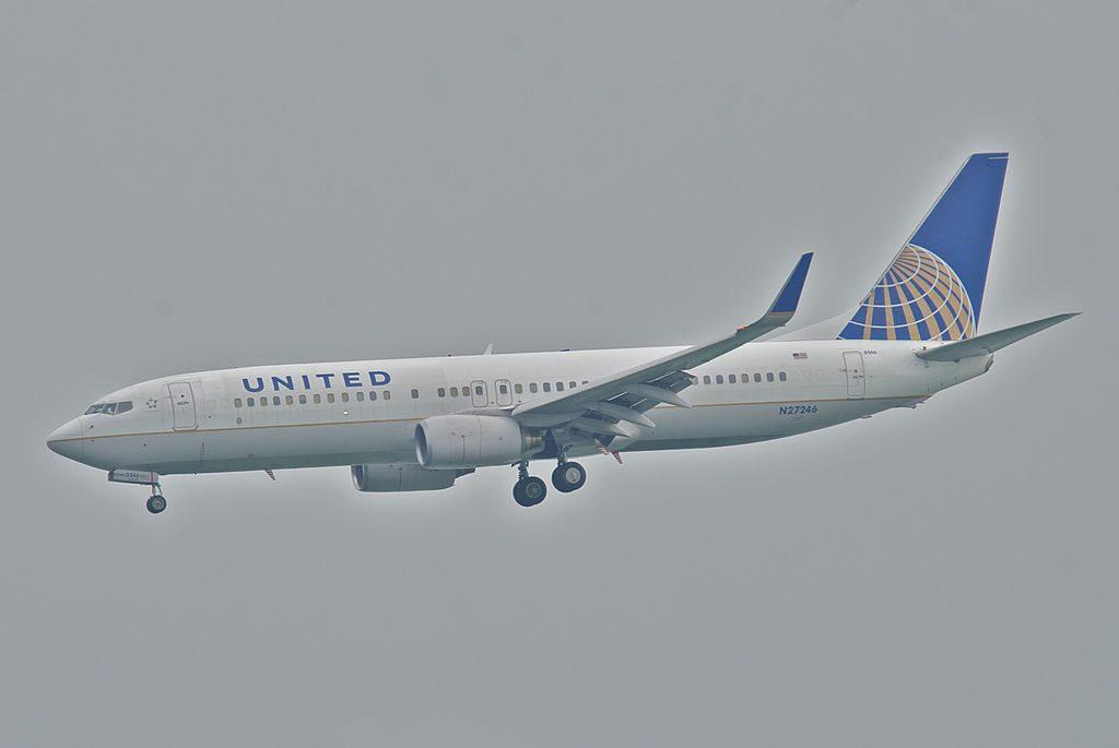 United Airlines Aircraft Fleet Boeing 737-800 N27246 on final before landing at HKG Hong Kong International Airport (IATA- HKG, ICAO- VHHH) Chek Lap Kok