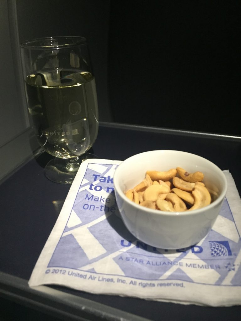 United Airlines Aircraft Fleet Boeing 737-900ER Business:First Class Cabin Inflight Amenities Beverages Services Peanuts and White Wine